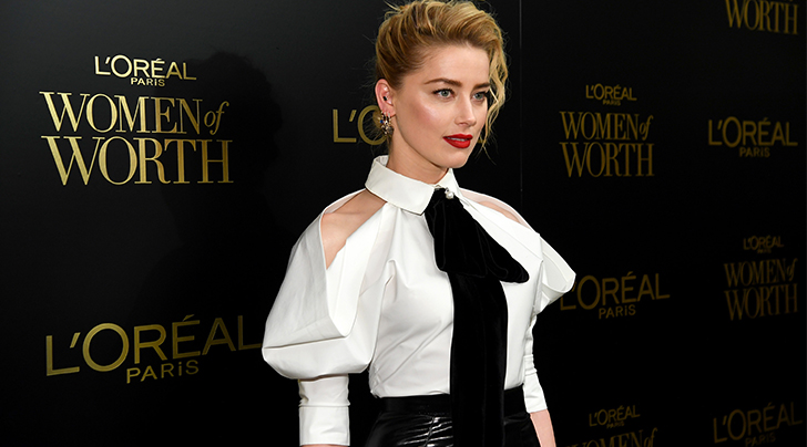 Amber Heard Reveals Why the Only Beauty Product She Needs Is Lipstick (and Vents About the Size of Women's Clutches)
